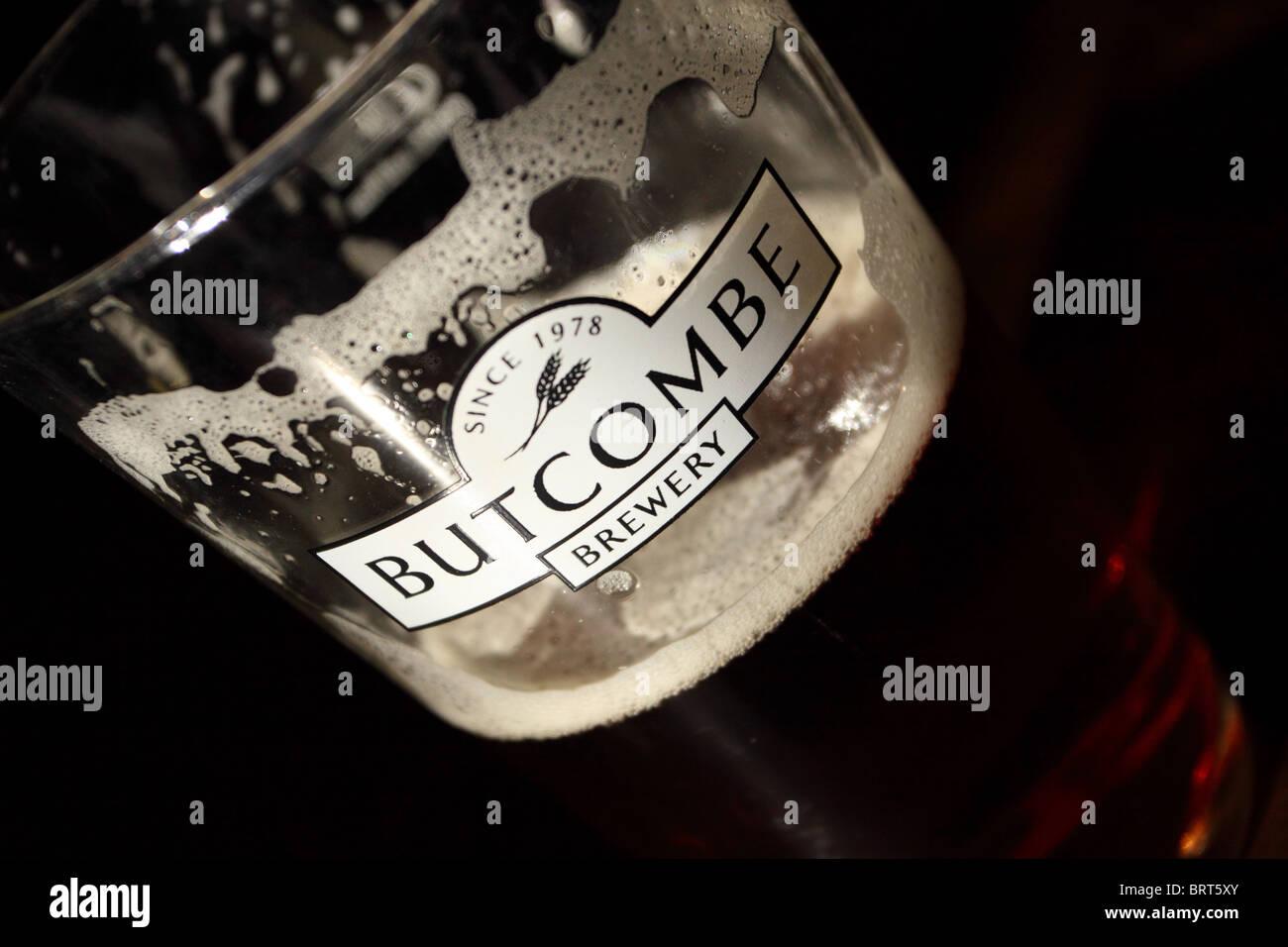 Butcombe Brewery beer glass half full local Somerset bitter beer - Stock Image