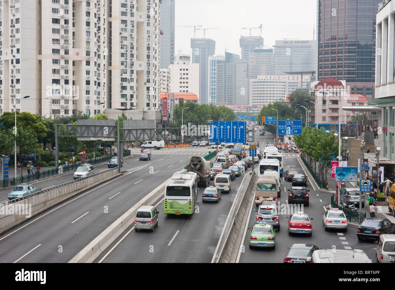 Wide streets with traffic congestion in Pudong, Shanghai China - Stock Image