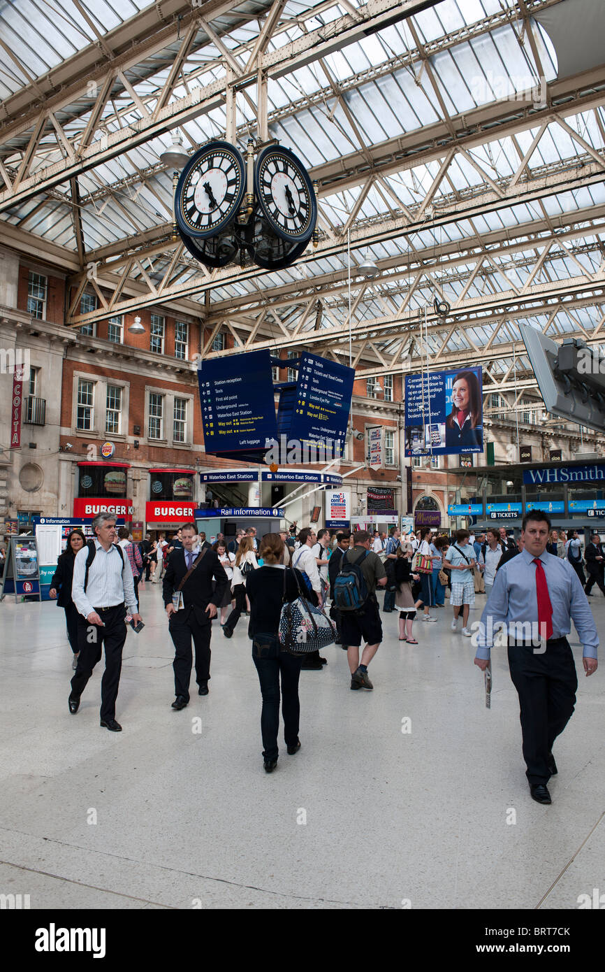 Suspended clock – famous as a meeting place/ landmark – in the concourse/ ticket hall at Waterloo station, London, - Stock Image