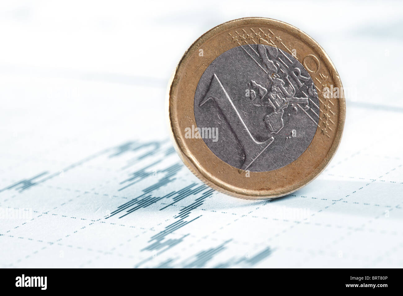 Business diagram on financial report with coins - Stock Image