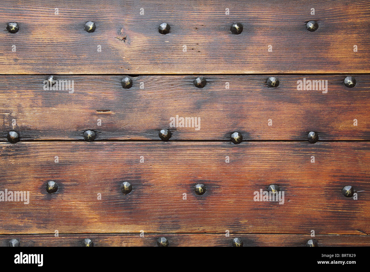 Wooden surface with nails, a background - Stock Image
