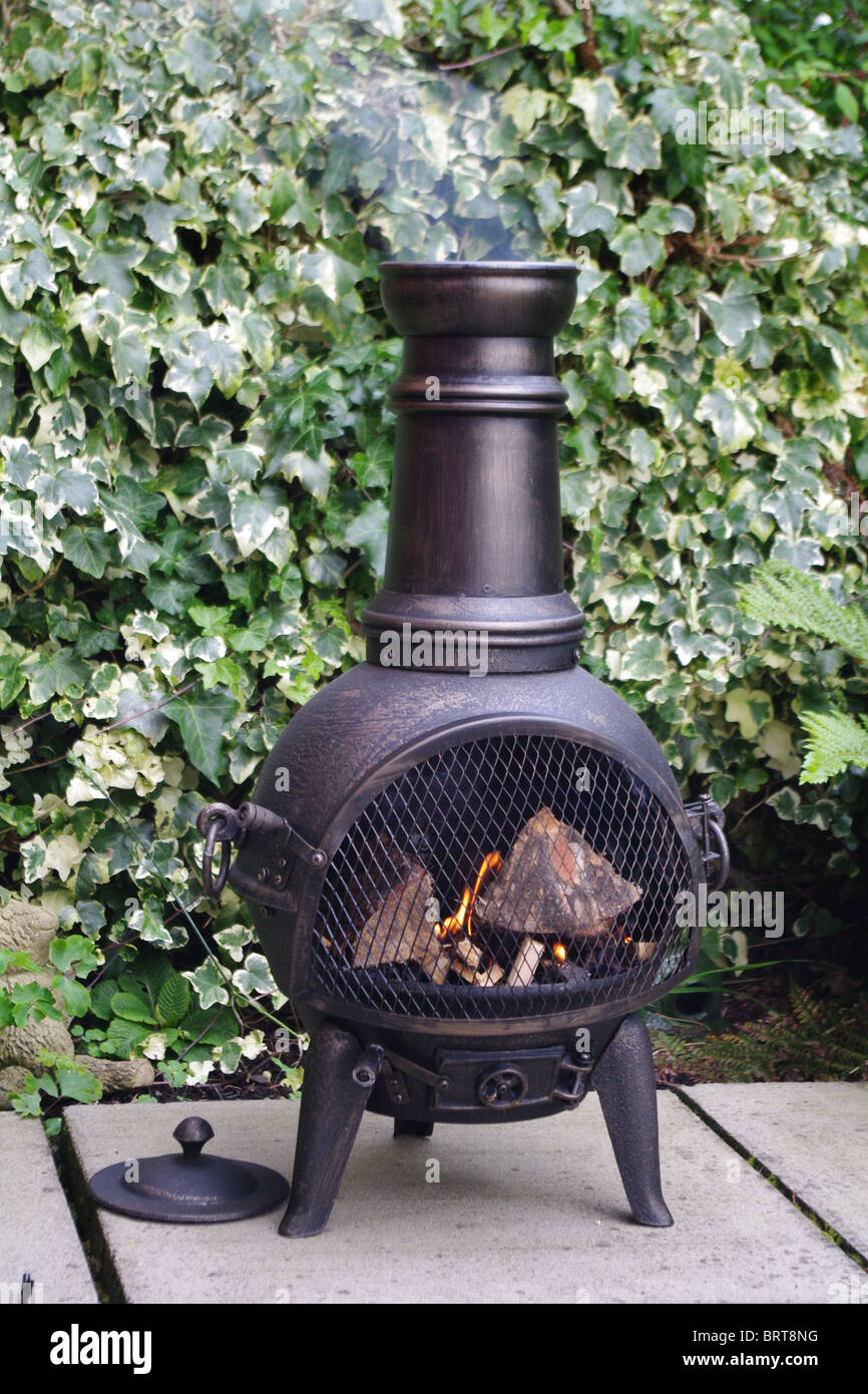 Chiminea Smoking In Garden Patio