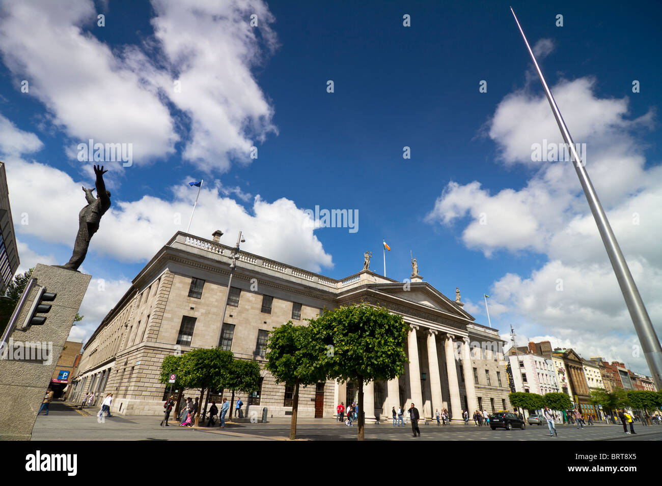 Dublin city centre with spire on O'Connell street, central Post office and monument of Jim Larkin - Stock Image