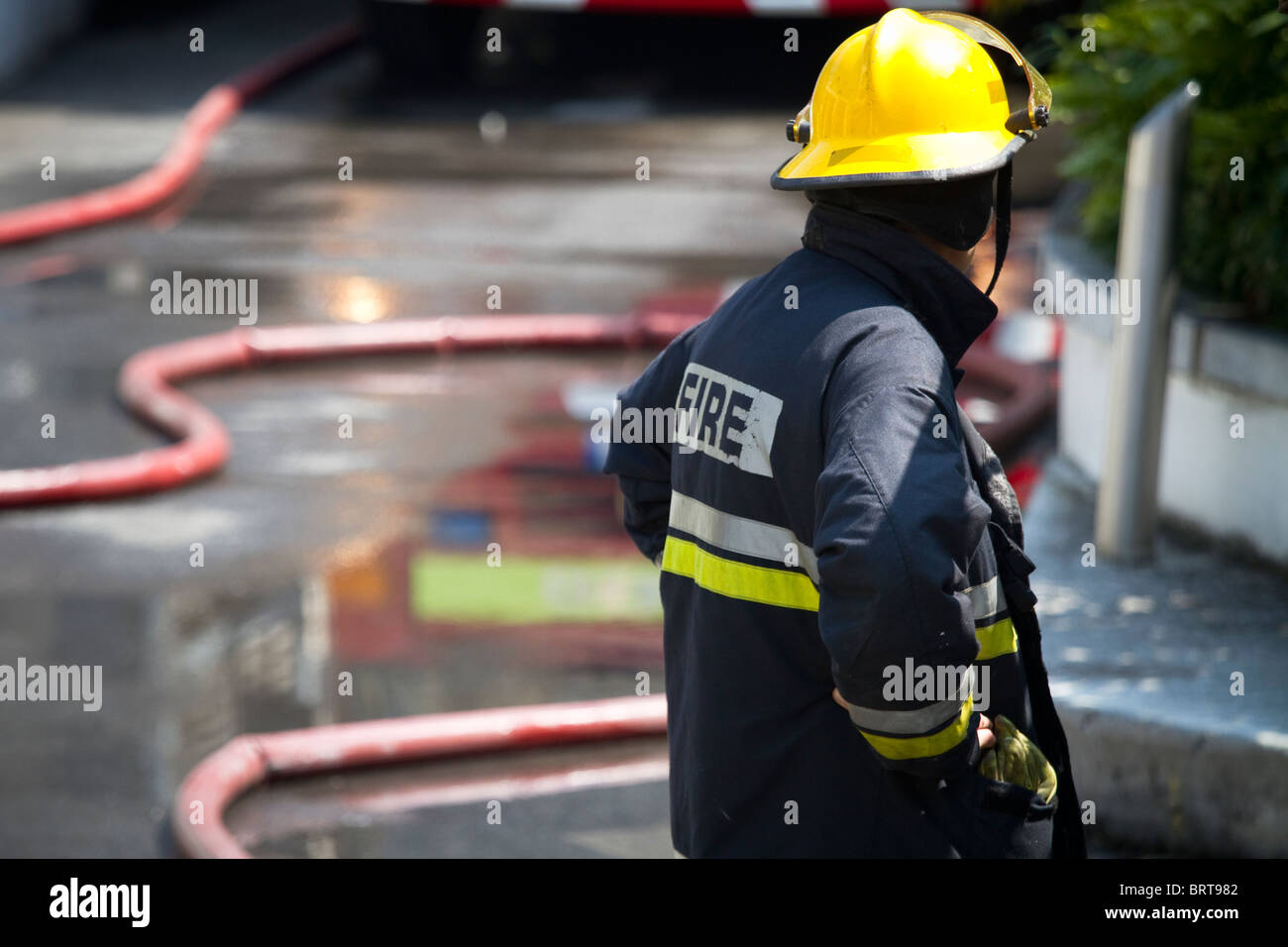 Firefighter brigade at work. Shallow depth of field. - Stock Image