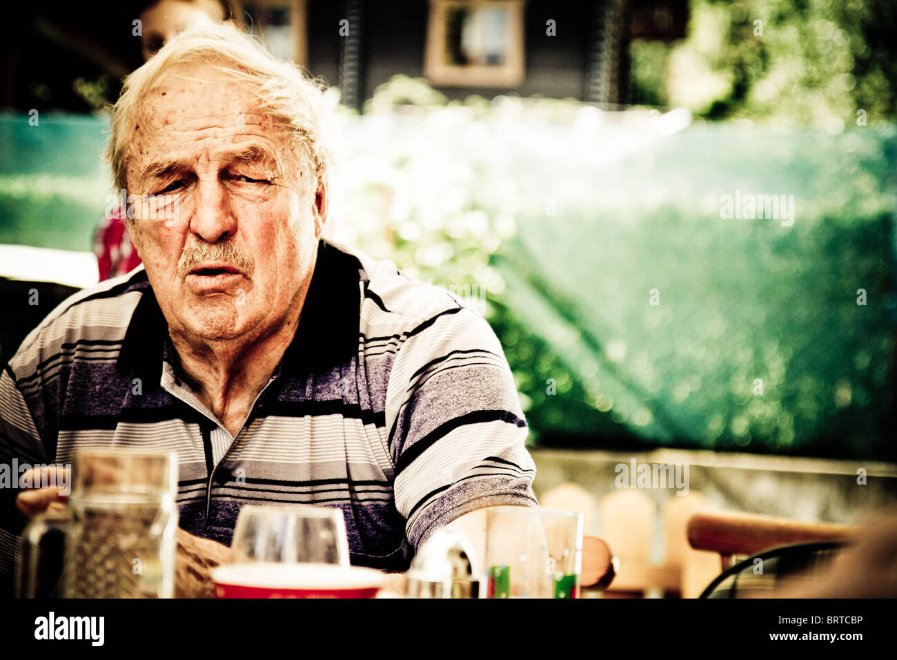 Old man stamped by his age and wisdom - Stock Image