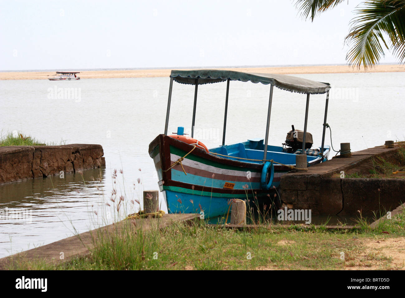 A motor boat parked in side of river bank - Stock Image