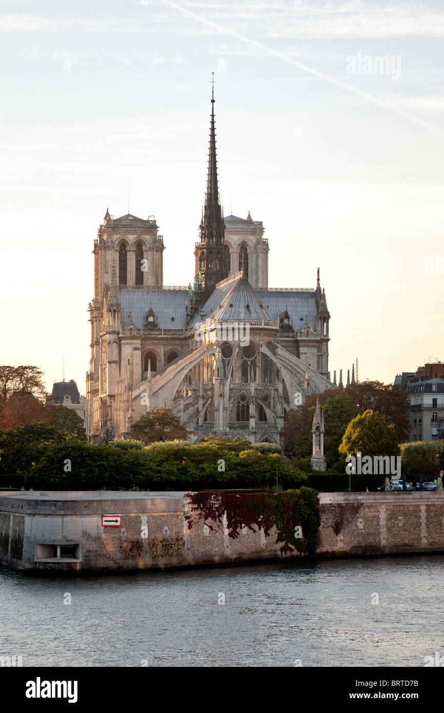 view of Notre Dame de Paris Cathedral with its delicate pink stone & Gothic tracery lit by autumn afternoon - Stock Image