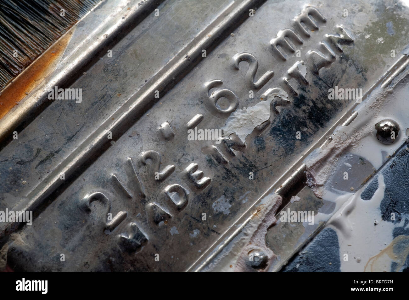Detailed image of the reverse side of a used Harris 2.5 inch (62 mm) paint brush - Stock Image