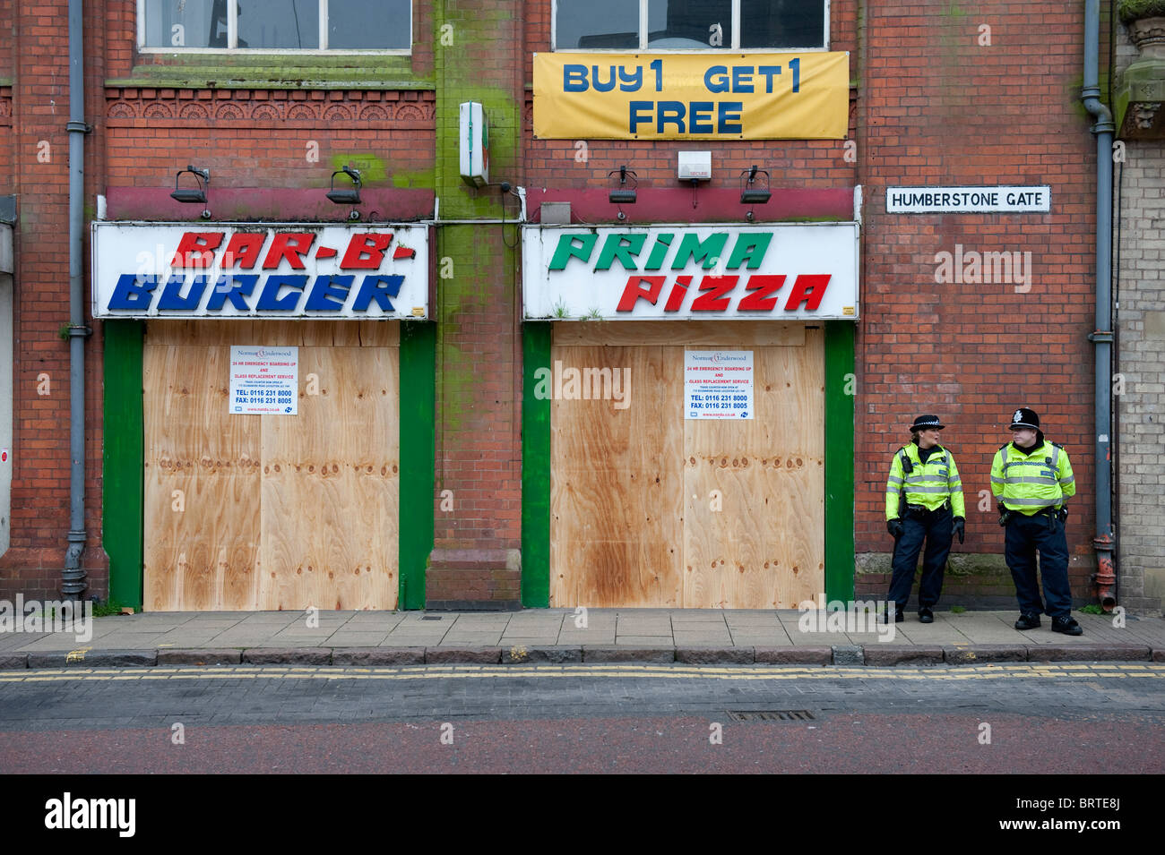 Boarded shops as The English Defence League demonstrate in Leicester. 9th October 2010. - Stock Image