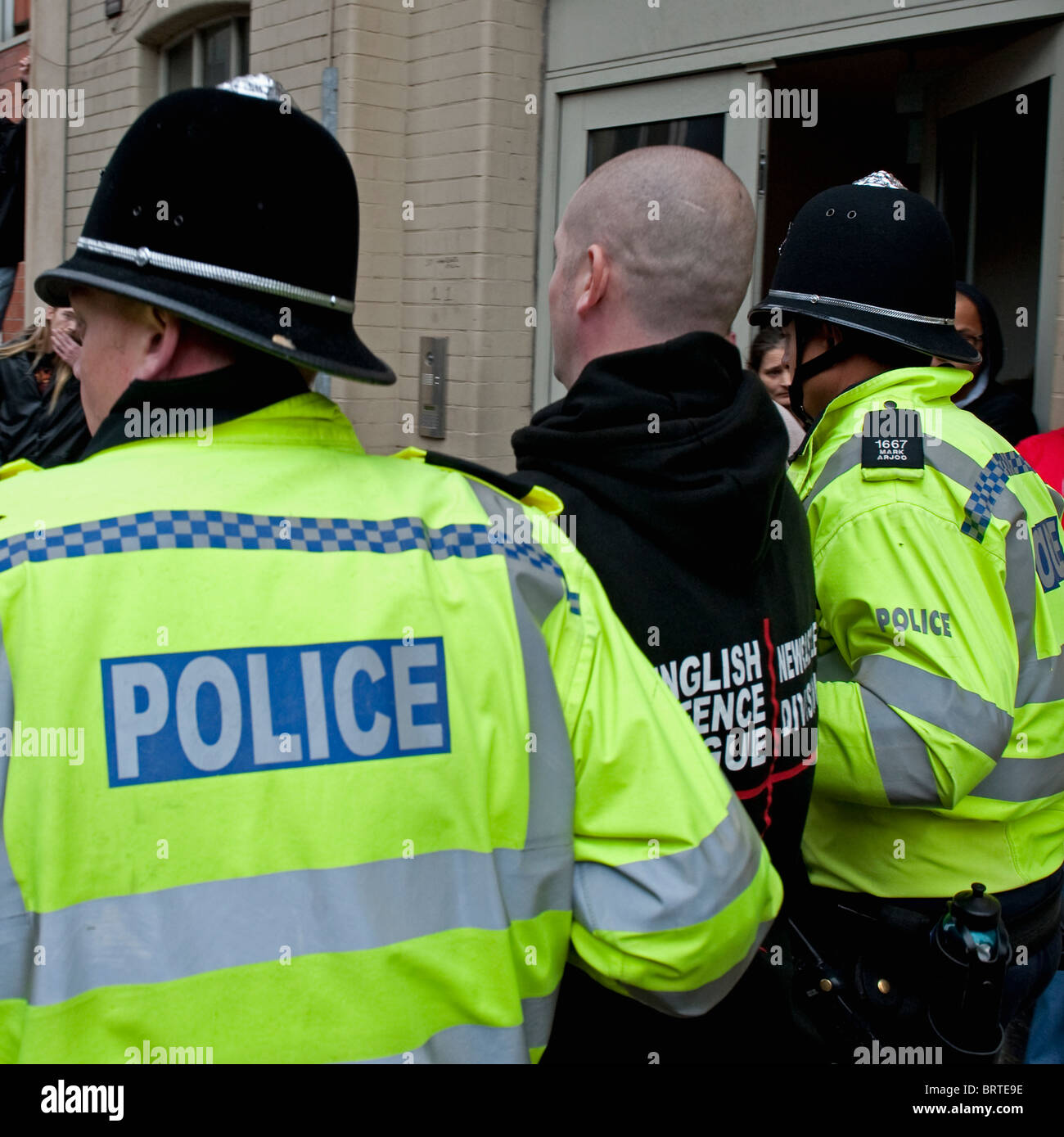 Police take away an EDL member as The English Defence League demonstrate in Leicester. 9th October 2010. Stock Photo