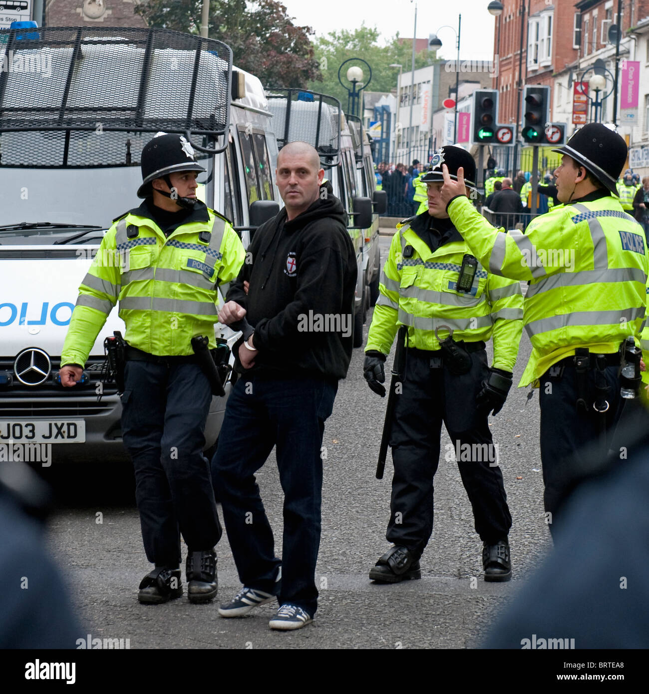 An EDL member is arrested as The English Defence League demonstrate in Leicester. 9th October 2010. - Stock Image