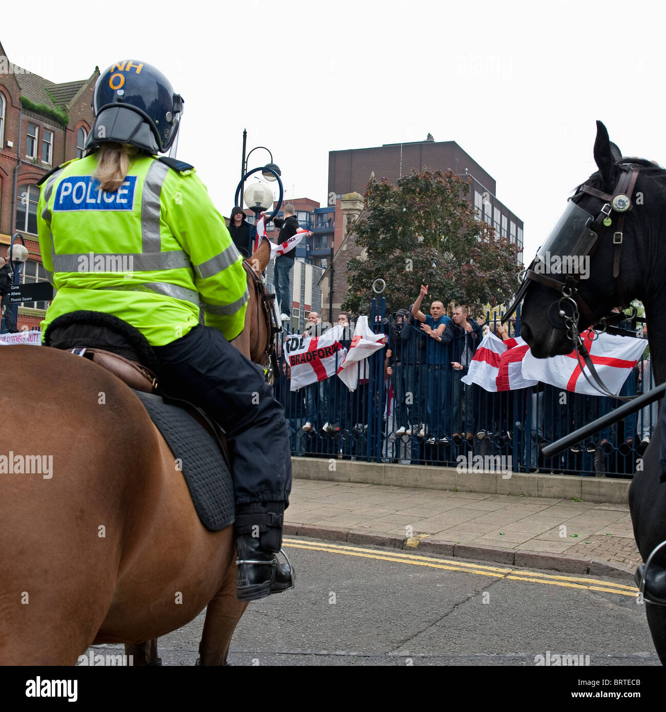 Mounted police guard as The English Defence League demonstrate in Leicester. 9th October 2010. - Stock Image
