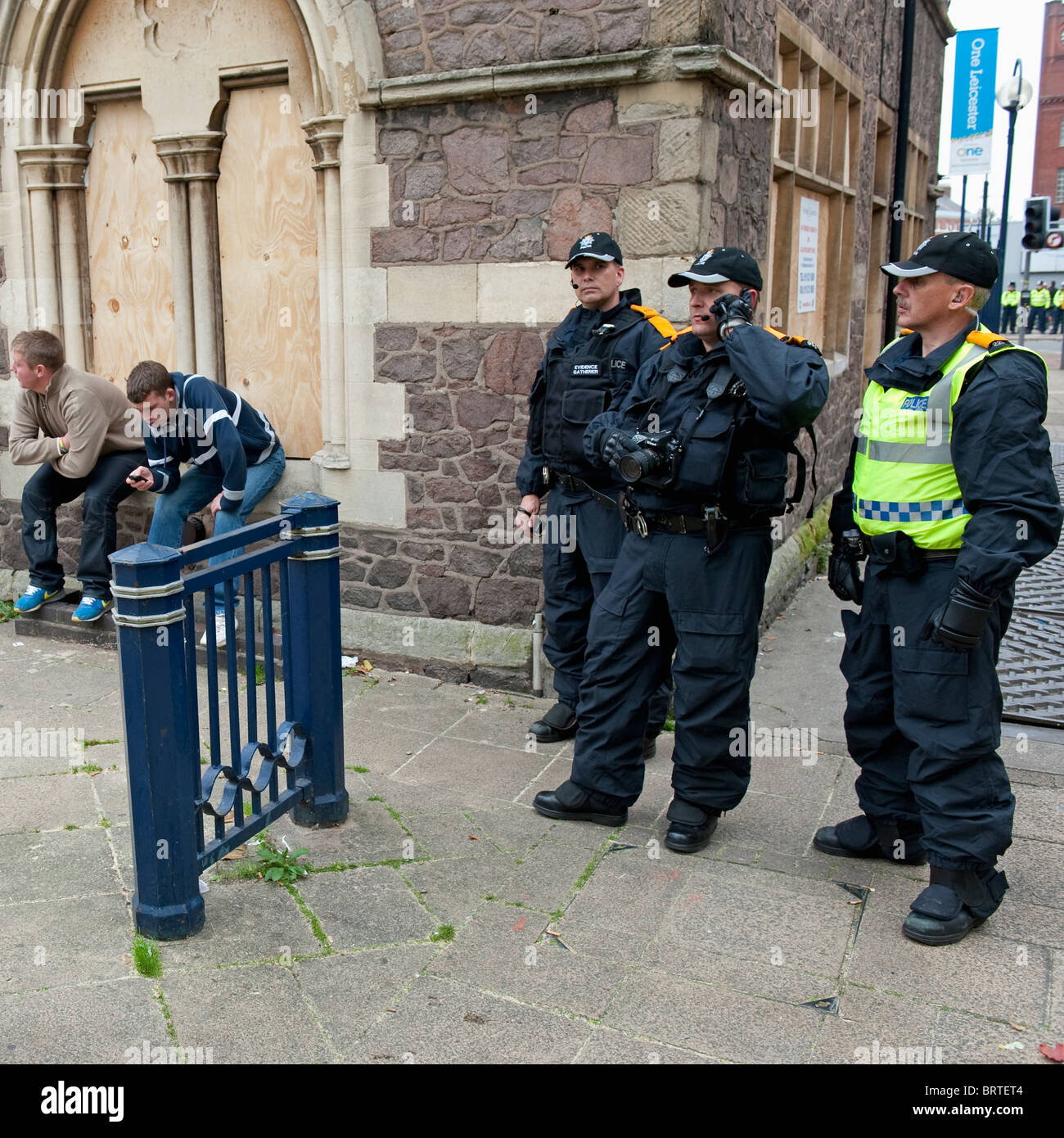 Police Surveillance Unit gather intelligence as The English Defence League demonstrate in Leicester. 9th October - Stock Image