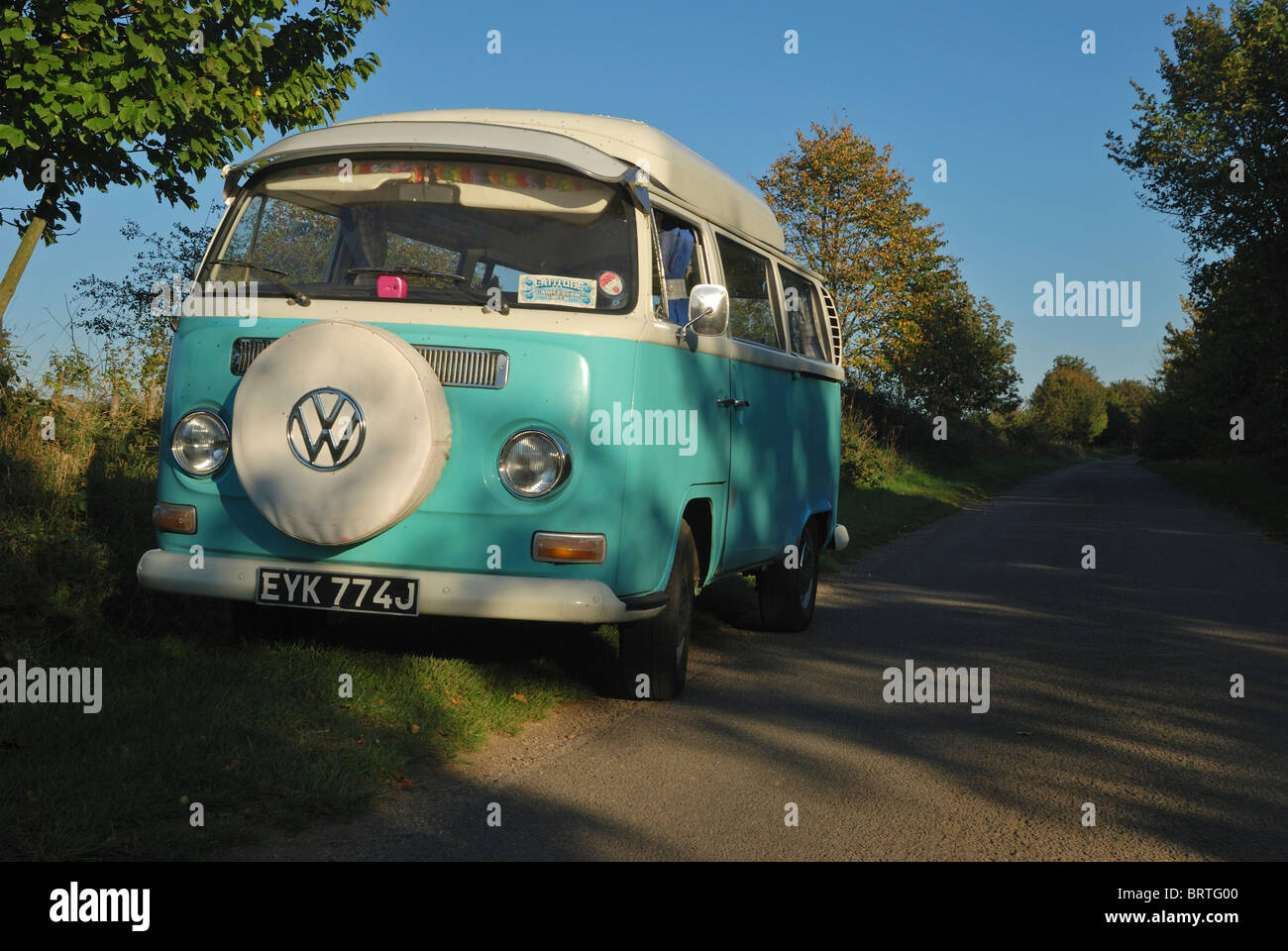 A VW camper van parked in a country lane in Lincolnshire, England. - Stock Image
