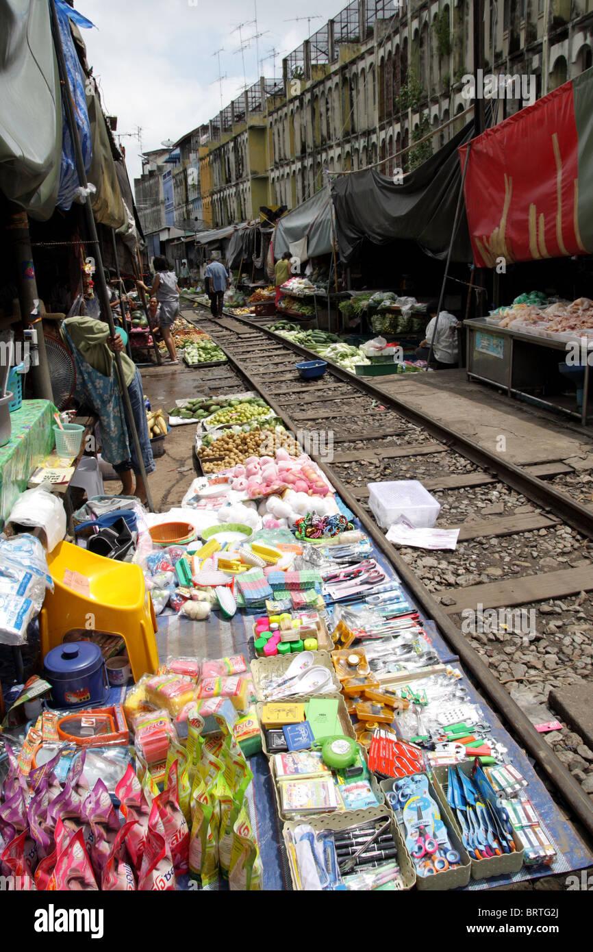 A food market on the rail tracks , Maeklong railway market , Thailand - Stock Image