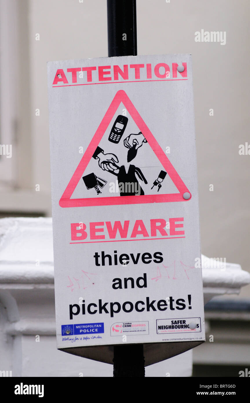 Attention Beware of Thieves and Pickpockets sign notice, Portobello Road, Notting Hill, London, England, Uk - Stock Image