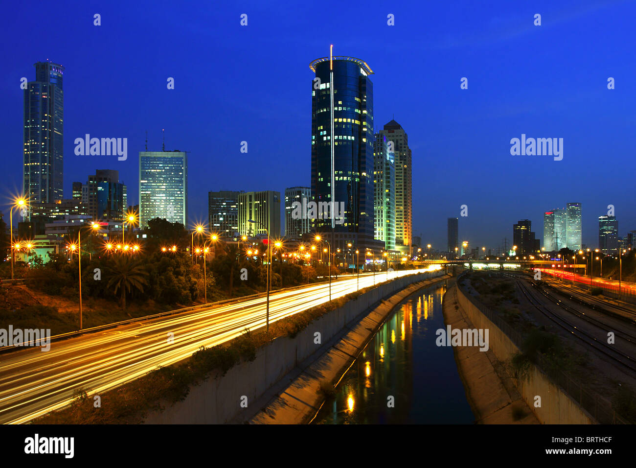 Tel Aviv downtown and Ayalon freeway at night. - Stock Image