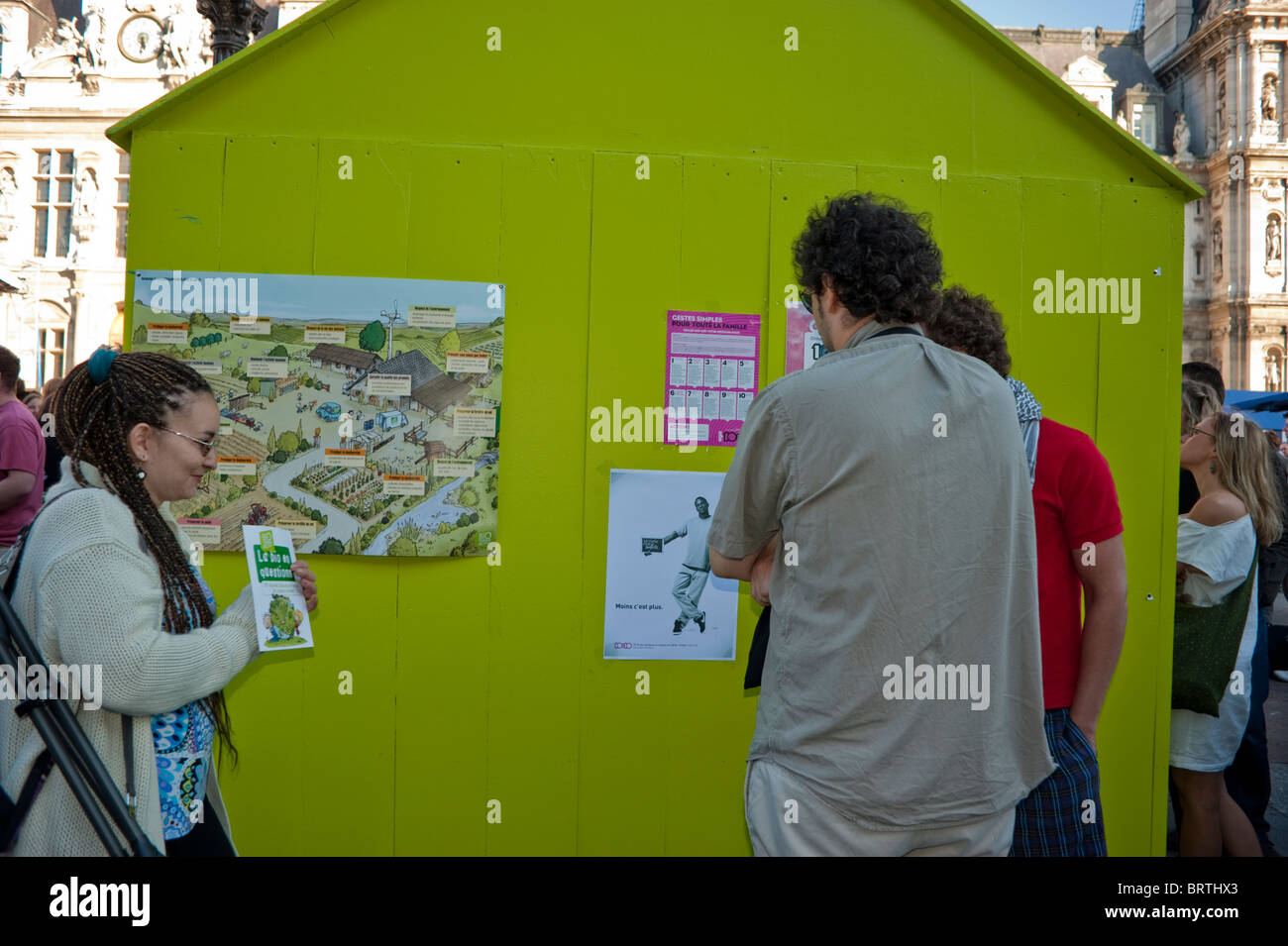 Paris, France - Exterior, Environmental Awareness Day, Young Adults Reading Poster on Wall, global green economy - Stock Image
