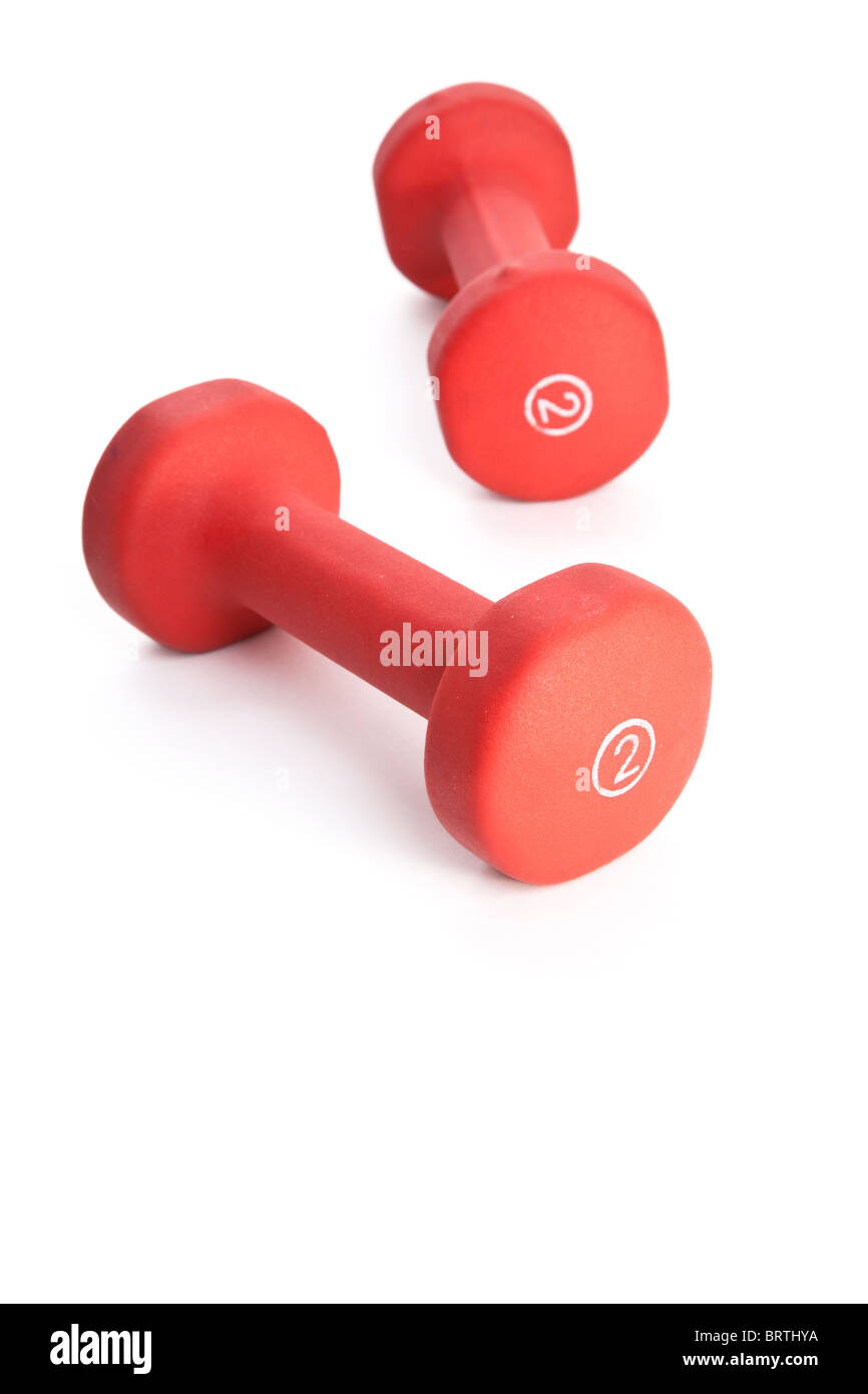 Red Dumbbell close up shot - Stock Image