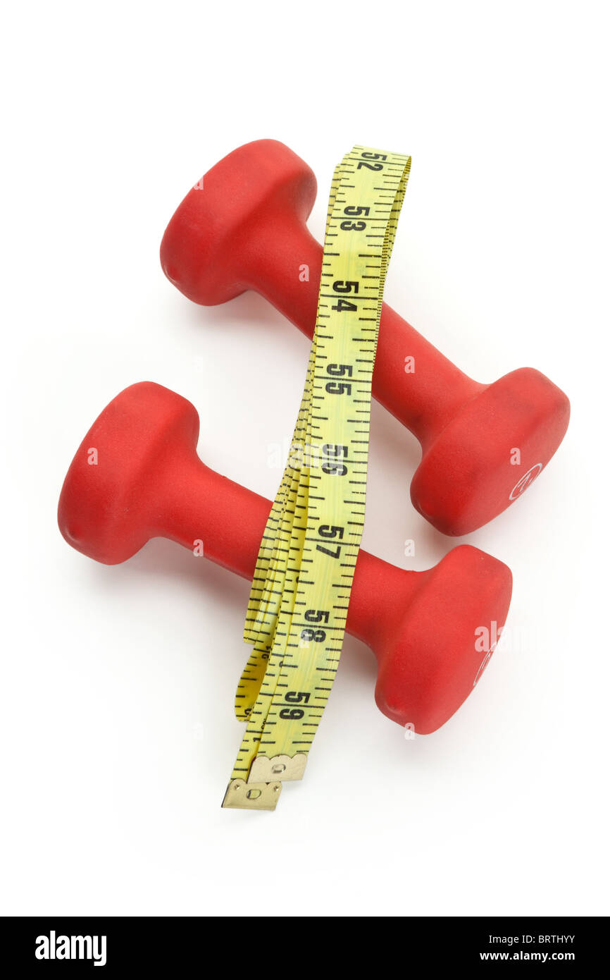 Red Dumbbell and Tape Measure close up shot - Stock Image