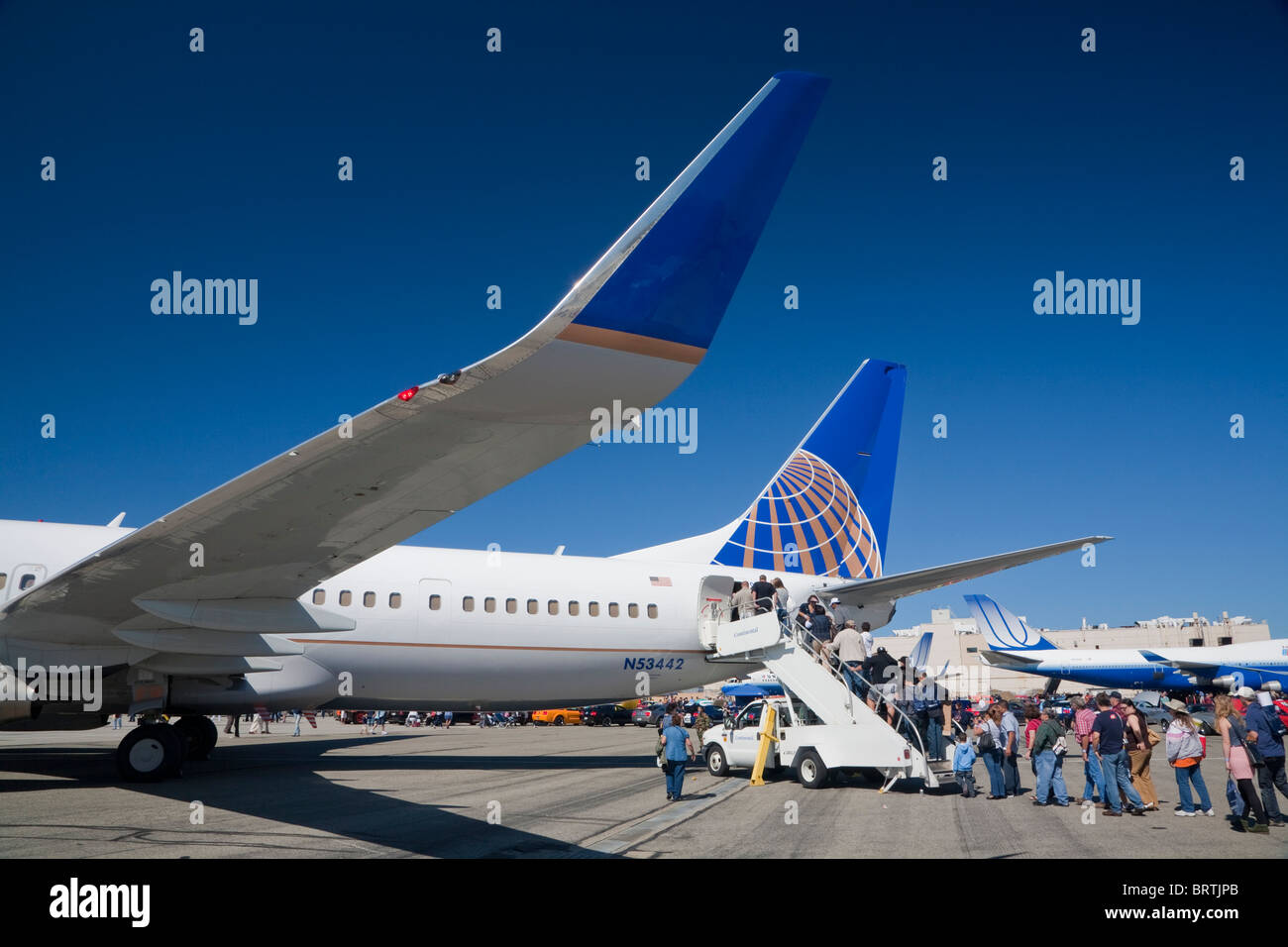 United Continental new airline company logo on airplane, with old United branded plane in background, October 10, - Stock Image