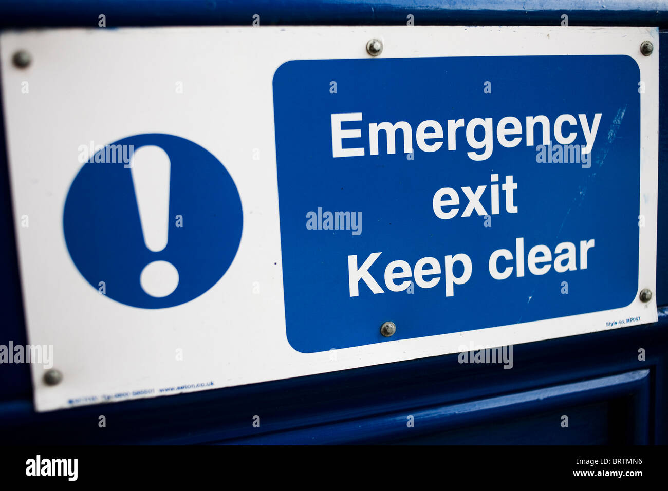 Emergency Exit Keep Clear door sign. - Stock Image