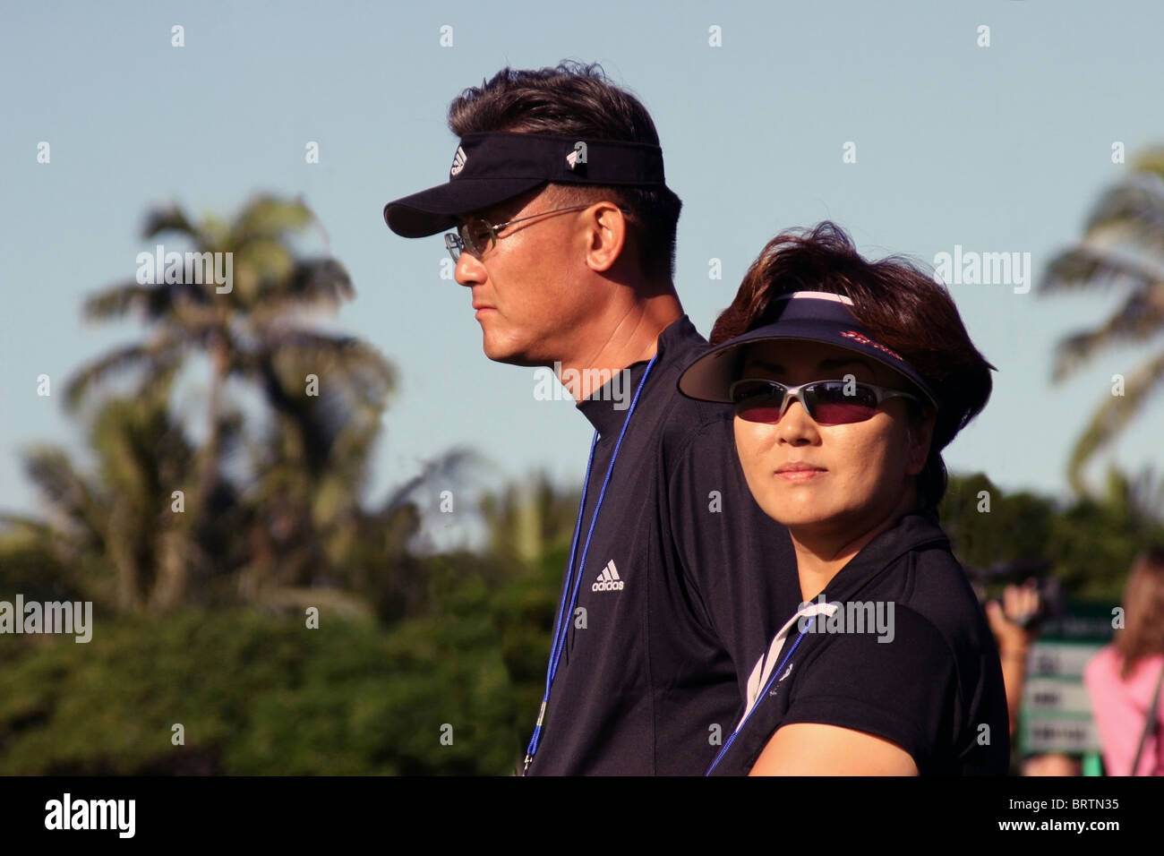 15 year old Michelle Wie's parents follow her on the course during a practice round prior to the PGA 2005 Sony - Stock Image