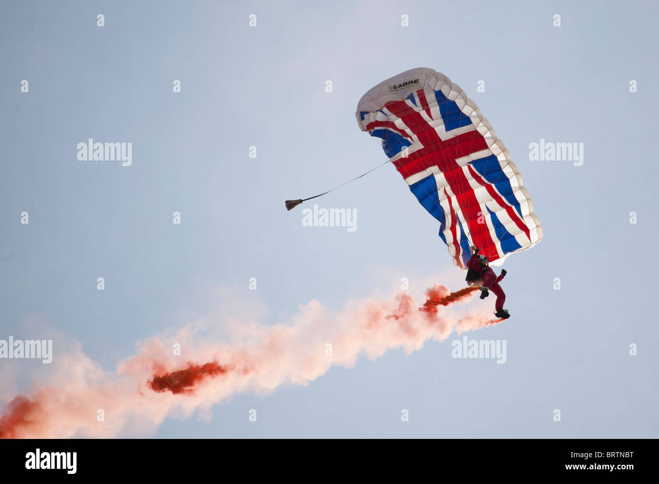 Red Devils bringing in the start flag at Silverstone. - Stock Image