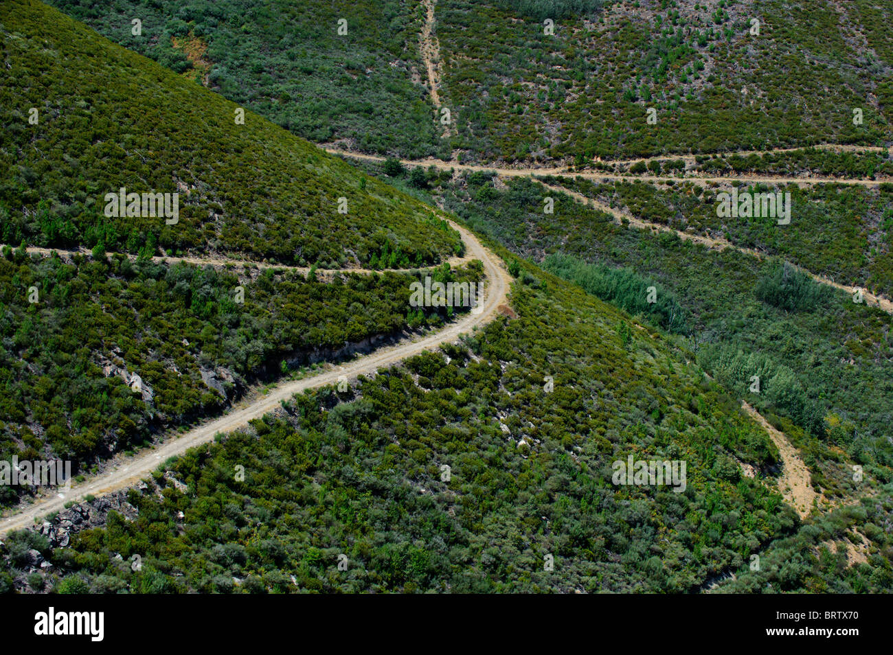Rural roads and footpaths on a green hillside - Stock Image