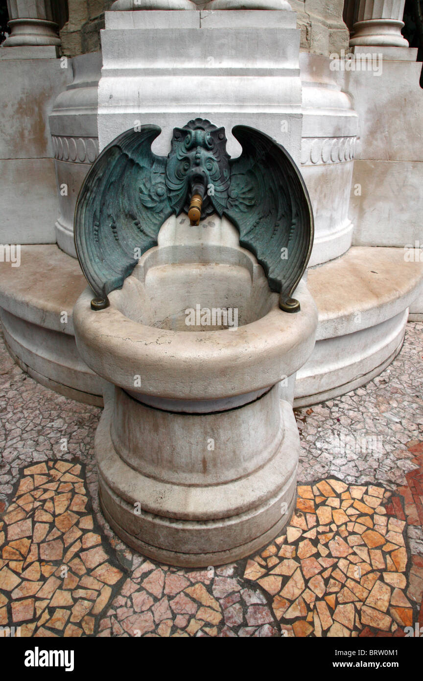 Capture  of a public drinking fountain fashioned into a mythalogical bat-like creature in  Bilbao, Spain Stock Photo