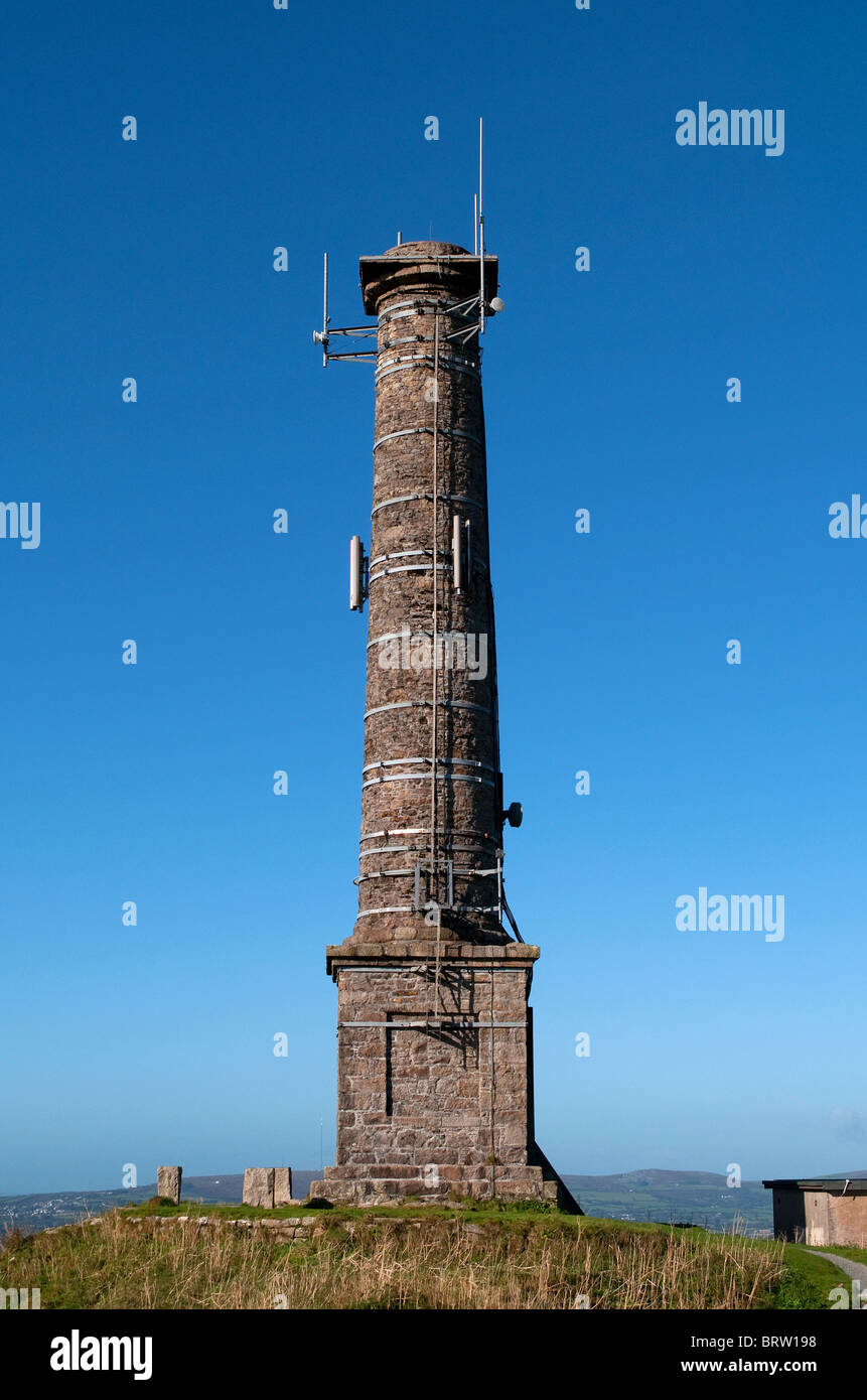 An old mine chimney now used for aerials and transmitters on the summit of Kit Hill near Callington in Cornwall, - Stock Image