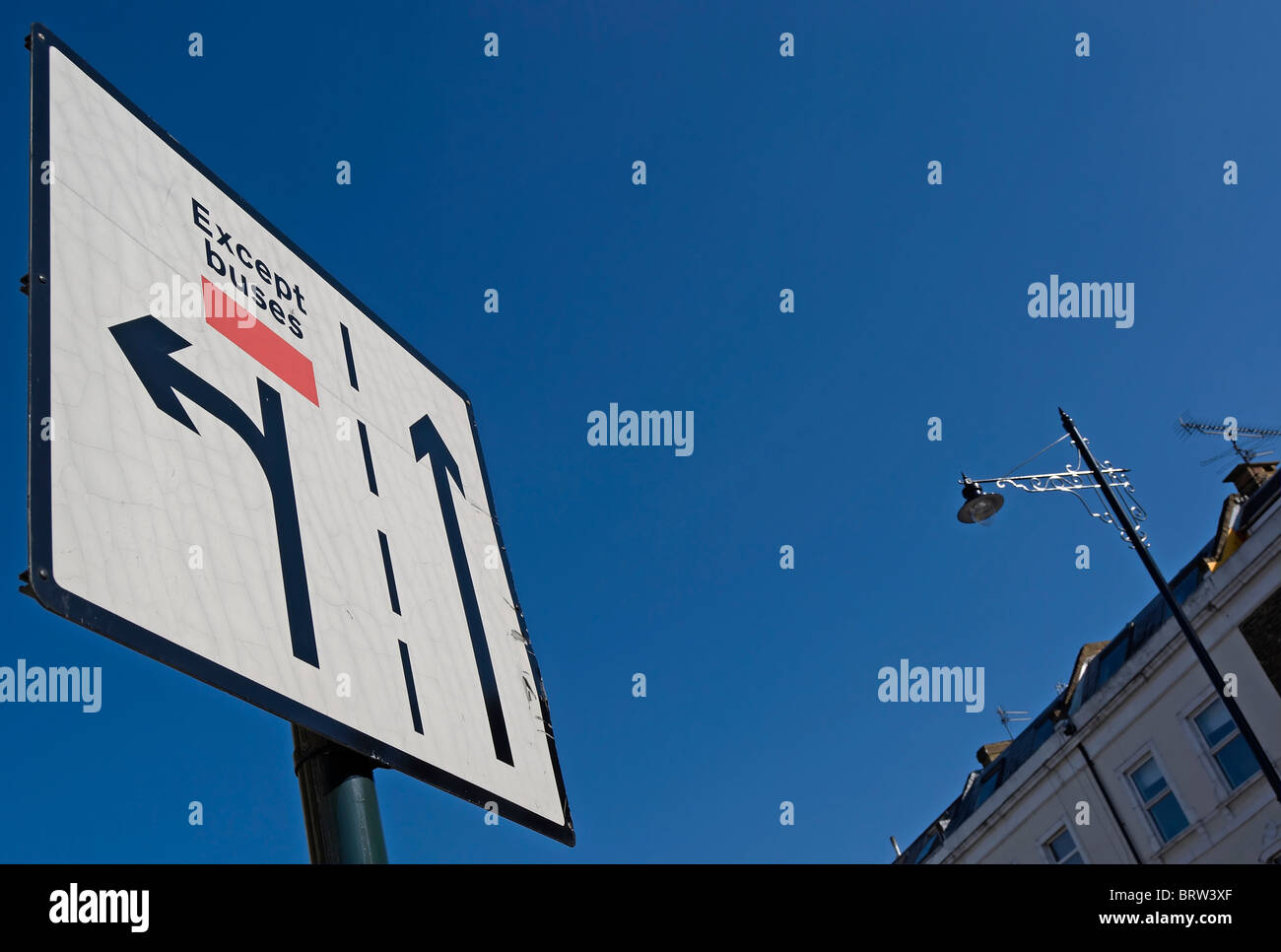 british road sign indicating left hand lane for turning left only, except buses, castelnau, london, england Stock Photo