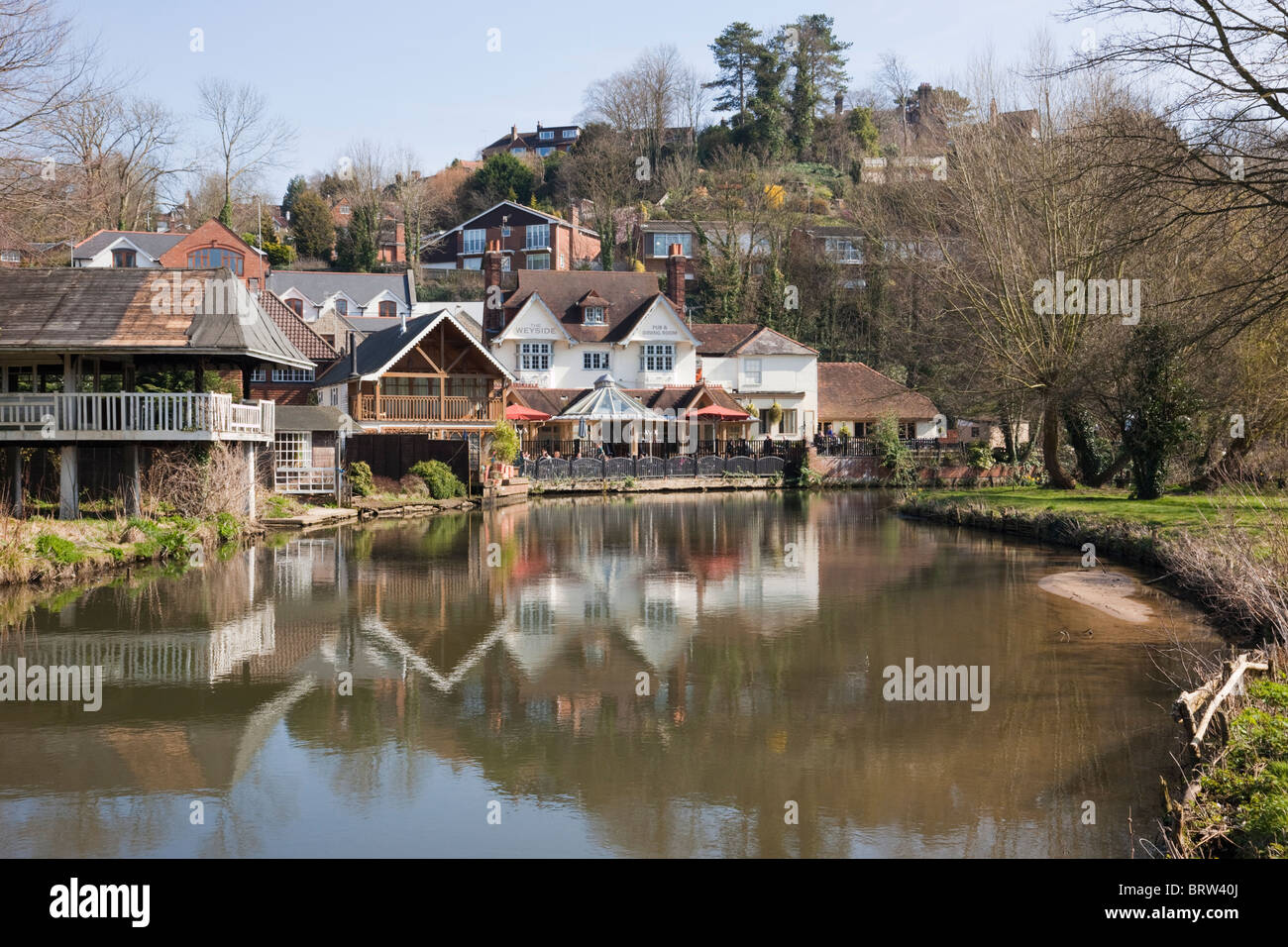 The Weyside riverside pub reflected in River Wey on Godalming Navigation Guildford Surrey England UK - Stock Image