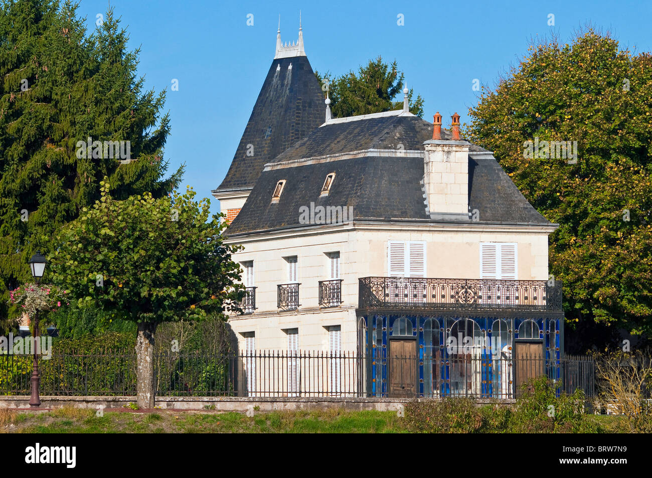 Riverside house with glazed front conservatory and balcony - sud-Touraine, France. Stock Photo