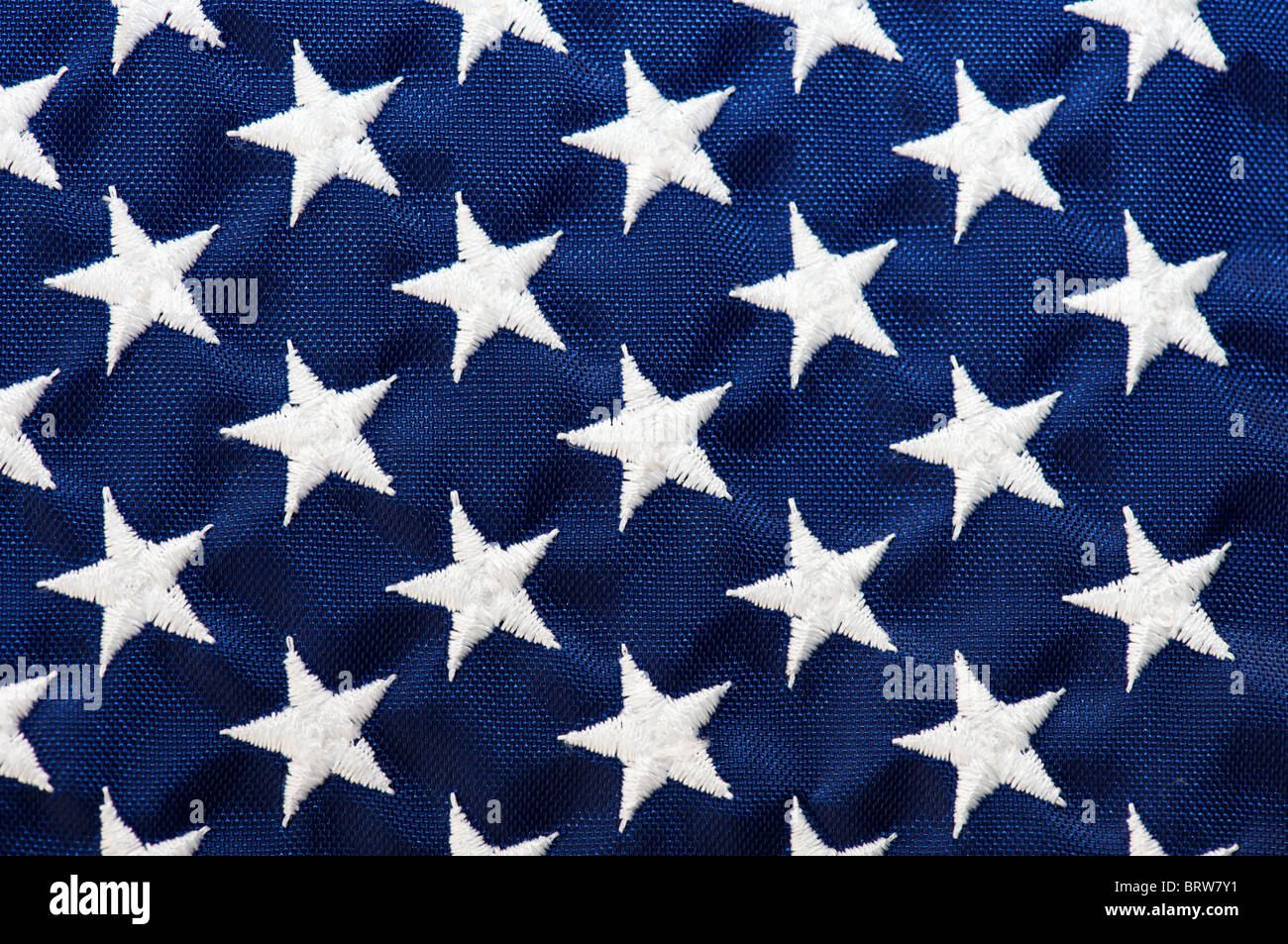 Star field of an American Flag, white stars on blue background - Stock Image