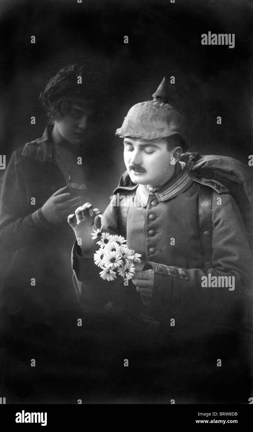 First World War soldier, she loves me, she loves me not, historic photgraph, around 1915 - Stock Image