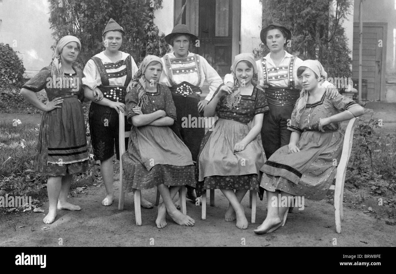 Group of women, some dressed in men's, some in women's traditional Bavarian costumes, historic photgraph, - Stock Image