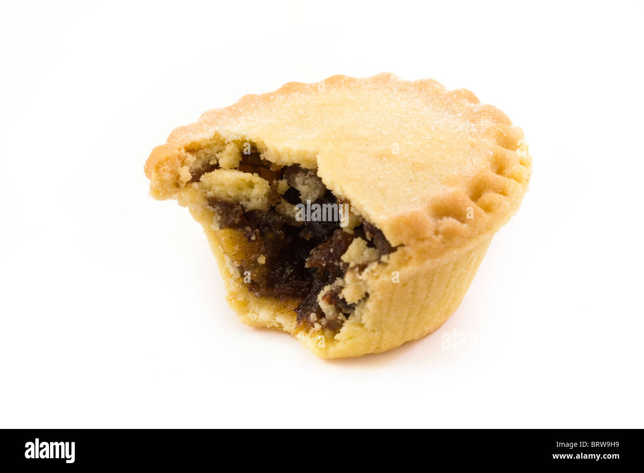 single mince pie with a missing bite - Stock Image