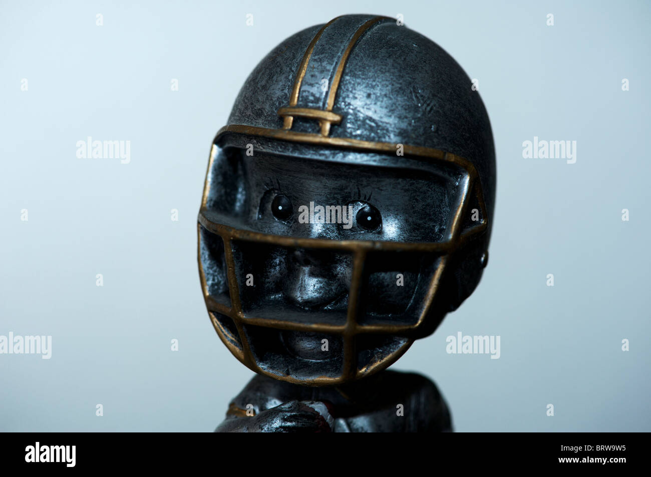 Youth football player figurine - Stock Image