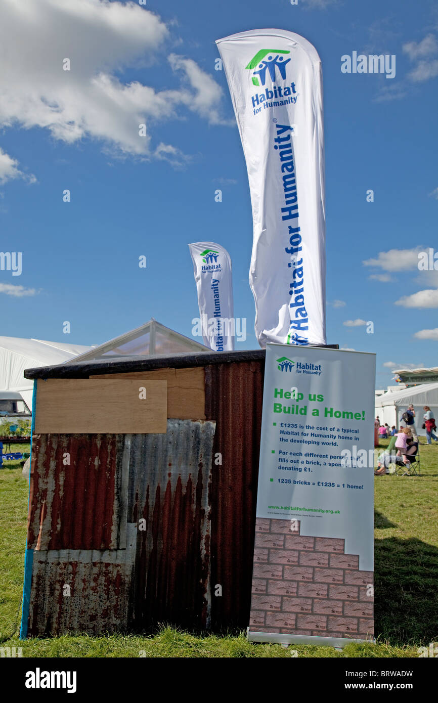 Habitat for Humanity help us build a home visitor exhibit Greenbelt Festival 2010 Cheltenham UK - Stock Image