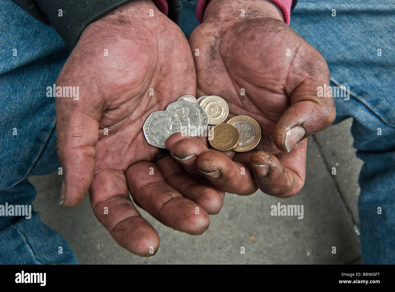 HOMELESS PERSON HOW MUCH CASH HE EARNED - Stock Image