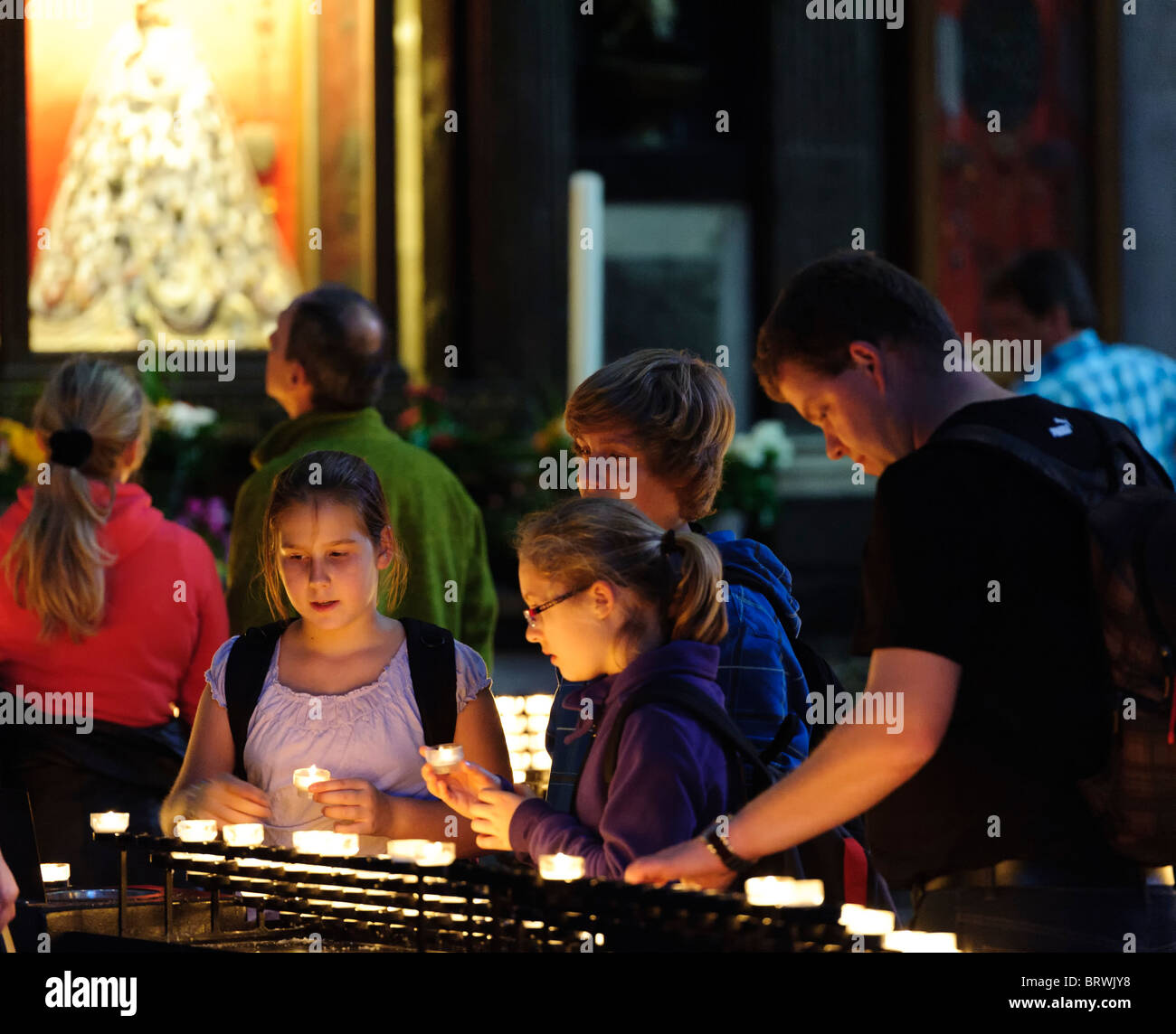 Lighting Candles in Remebrance in Cologne Cathedral - Stock Image