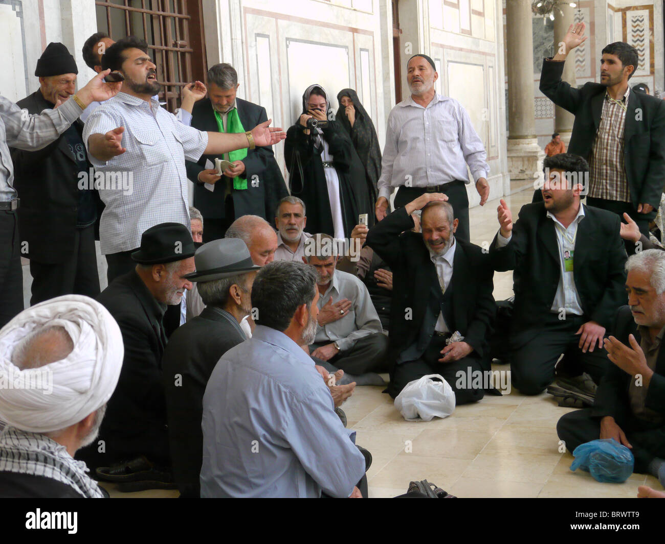 SYRIA Inside the Ummayad Mosque, Damascus. Iranian pilgrims taking time for prayer and reflection. PHOTOGRAPH by - Stock Image