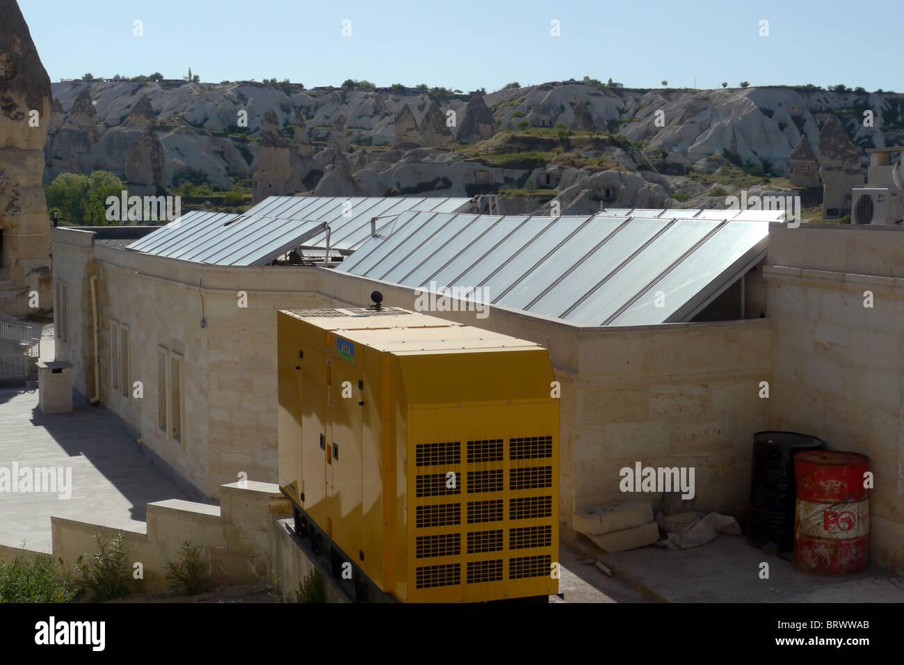 TURKEY Solar water heating panels on a hotel, Goreme, Cappadocia. photo by Sean Sprague - Stock Image
