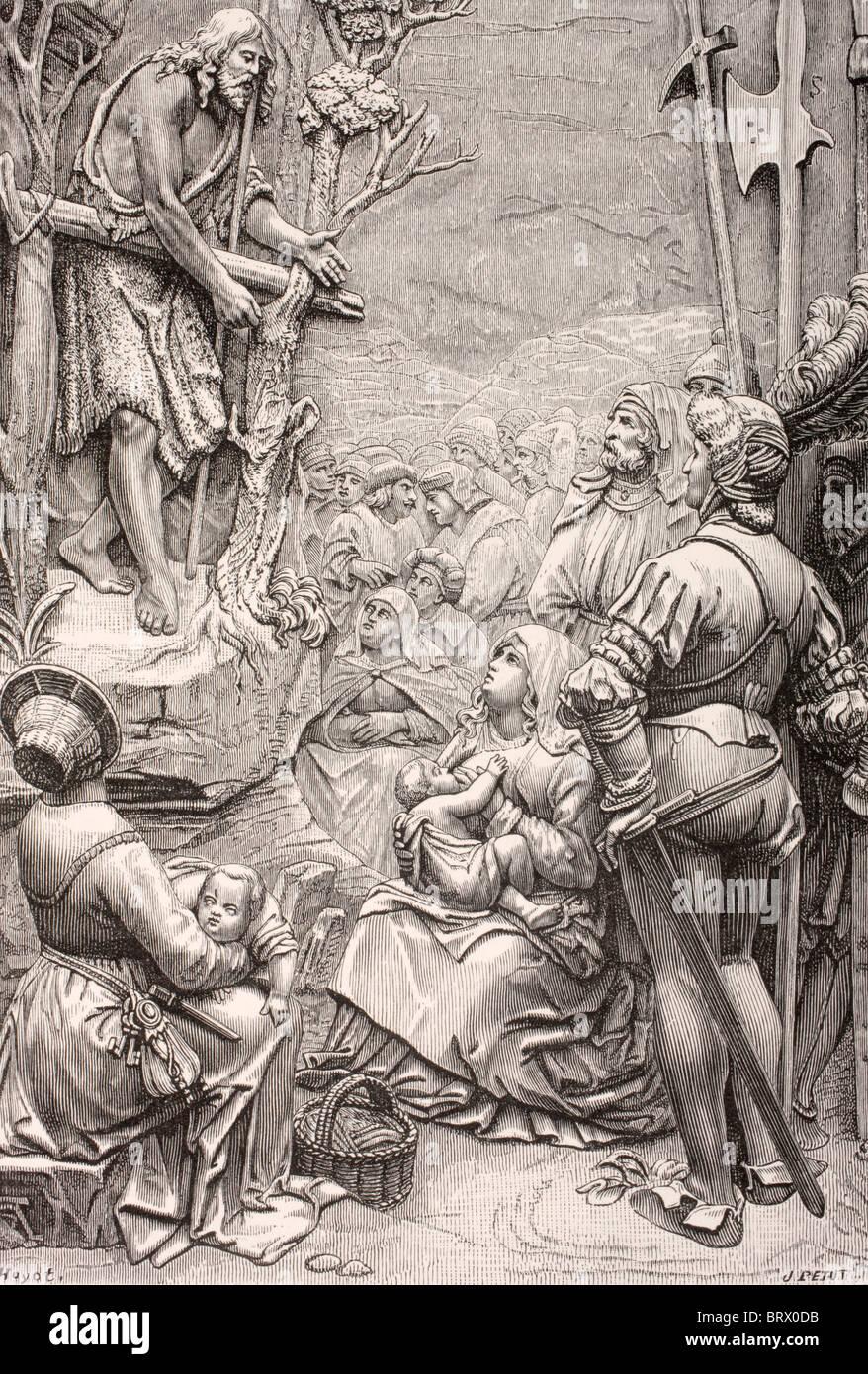 Saint John the Baptist preaching in the desert. - Stock Image