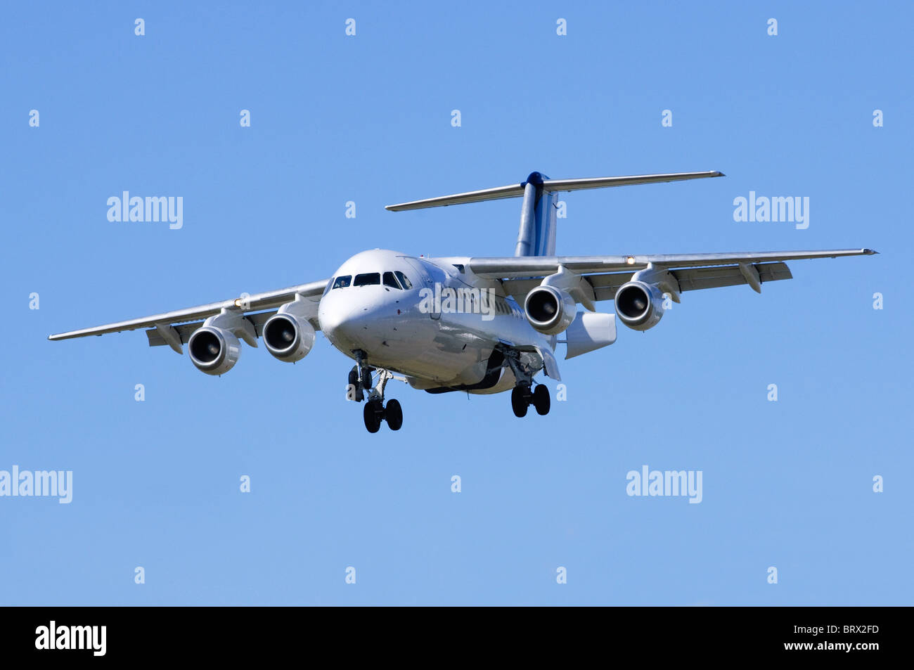 British Aerospace BAe 146-200 operated by BAE Systems on approach for landing at London Farnborough Airport - Stock Image
