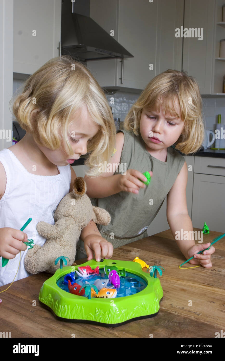 Children fight with game - Stock Image