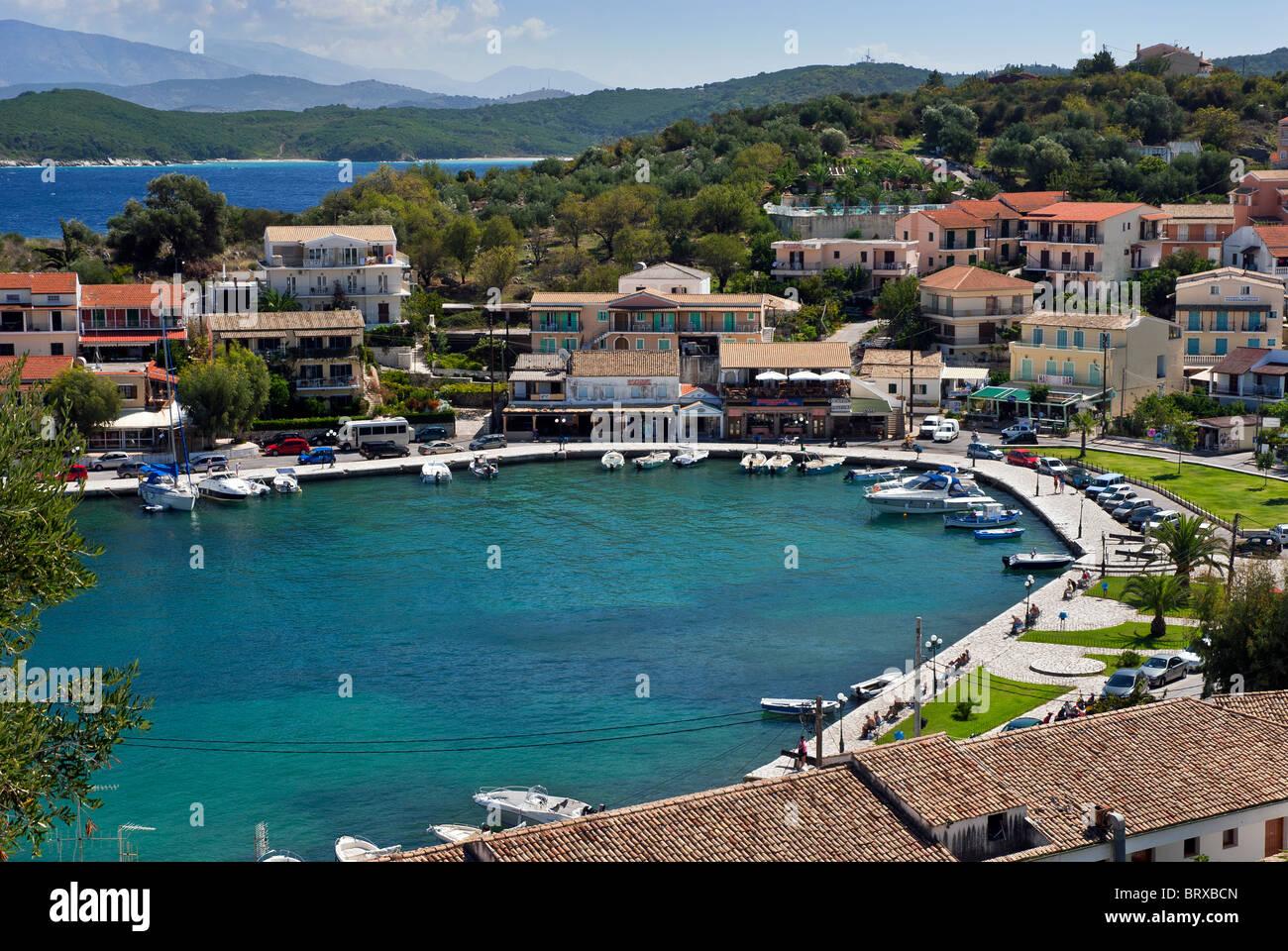 Kassiopi Village Bay Harbour, Corfu, Ionian Islands Greece. Stock Photo