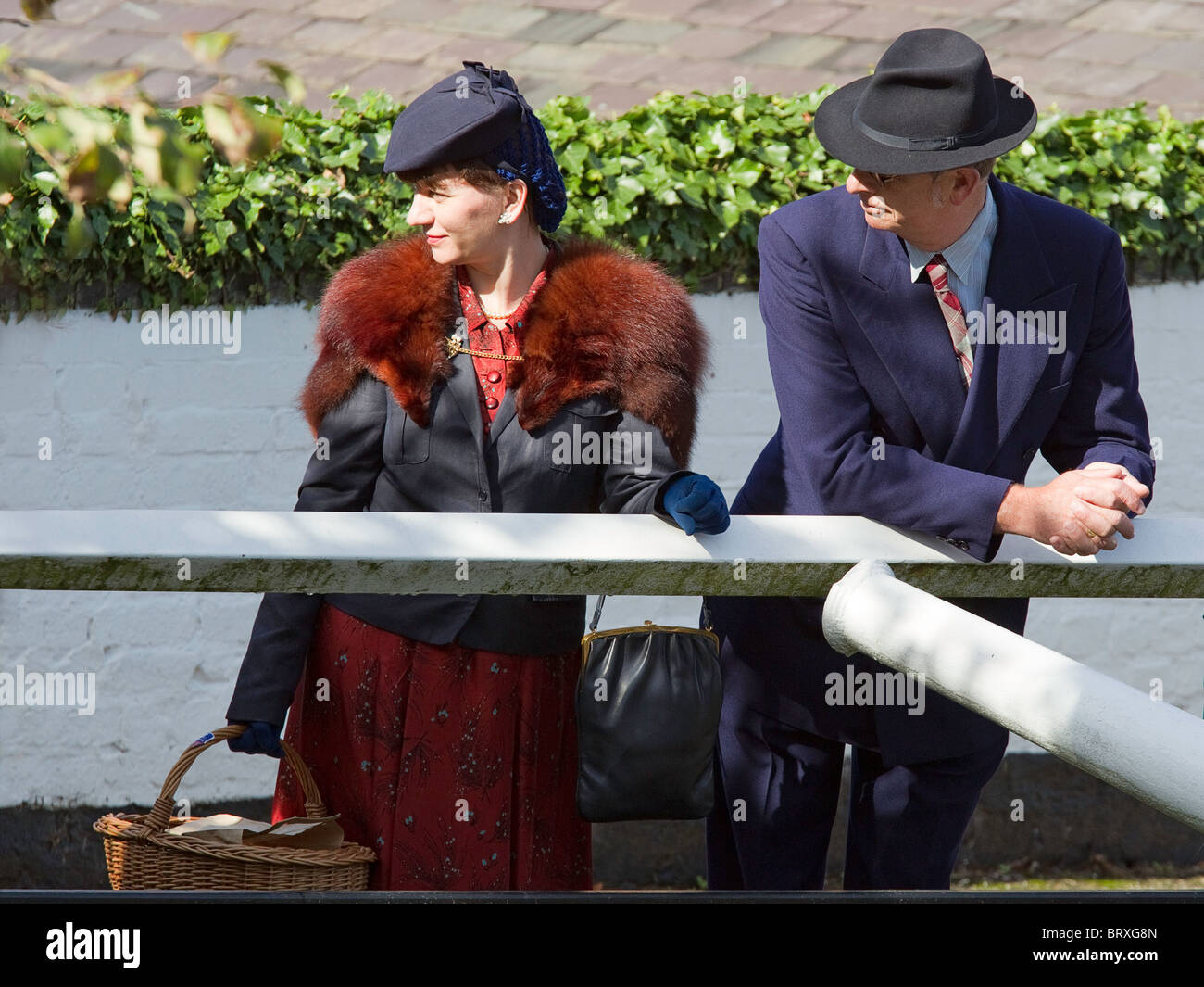 1940 s Man in Trilby   Suit with Lady in Hat with Fur Stoal   Picnic Basket 0860371d721