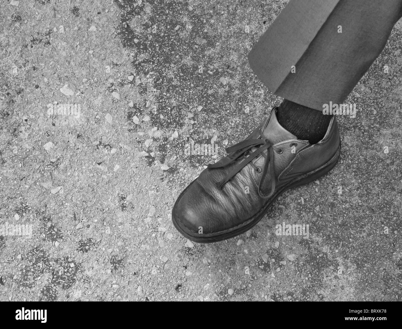 Close-up of an old man's leg and shoe. B&W - Stock Image